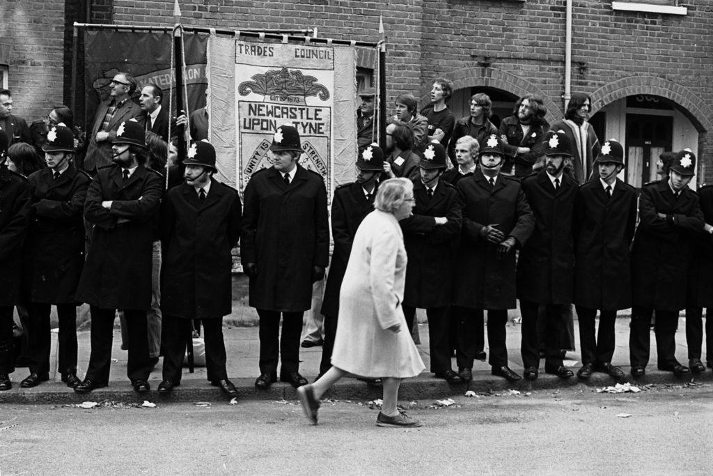 Resident walking past police line Grunwick 1978